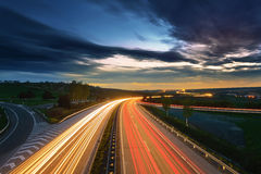 Long-exposure sunset over a highway Stock Image