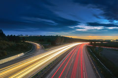 Long-exposure sunset over a highway. With light trails Royalty Free Stock Images