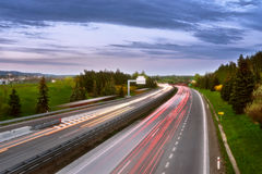 Long-exposure sunset over a highway Royalty Free Stock Image