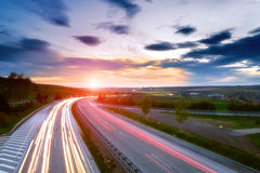 Long-exposure sunset over a highway Stock Images
