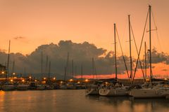 Long exposure sunset over old harbor boats heraklion stock photo