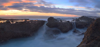 Long exposure of sunset over rocks Royalty Free Stock Image