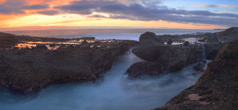 Long exposure of sunset over rocks Stock Photos