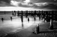 Long exposure at sunset of pier pilings in the Delaware Bay at S Royalty Free Stock Photo