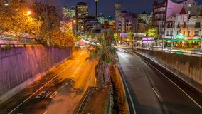 Kings Cross, Sydney, Australia. Long exposure time lapse footage with slide effect of a busy road at rush hours in Kings Cross, Sydney, Australia stock footage