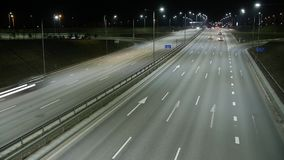 Long Exposure Time Lapse of Night Traffic in Vilnius, Lithuania. High-angle view from a bridge stock footage
