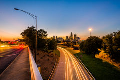 Long exposure of traffic on the Andrew Jackson Highway and view. Of the Uptown Charlotte skyline at night, from the Central Avenue Bridge, in Charlotte, North Royalty Free Stock Photography