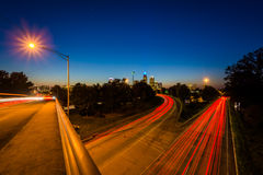 Long exposure of traffic on the Andrew Jackson Highway and view. Of the Uptown Charlotte skyline at night, from the Central Avenue Bridge, in Charlotte, North Stock Images