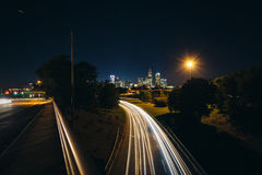 Long exposure of traffic on the Andrew Jackson Highway and view. Of the Uptown Charlotte skyline at night, from the Central Avenue Bridge, in Charlotte, North Royalty Free Stock Image