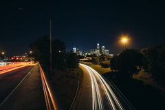 Long exposure of traffic on the Andrew Jackson Highway and view. Of the Uptown Charlotte skyline at night, from the Central Avenue Bridge, in Charlotte, North Royalty Free Stock Images