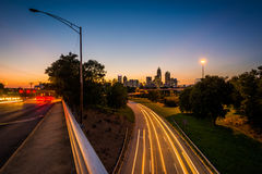 Long exposure of traffic on the Andrew Jackson Highway and view. Of the Uptown Charlotte skyline at night, from the Central Avenue Bridge, in Charlotte, North Stock Photo