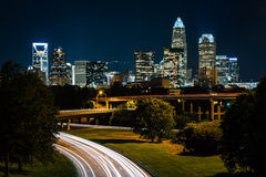 Long exposure of traffic on the Andrew Jackson Highway and view. Of the Uptown Charlotte skyline at night, from the Central Avenue Bridge, in Charlotte, North Stock Photography