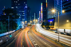 Long exposure of traffic on Connaught Road and skyscrapers at ni Royalty Free Stock Images