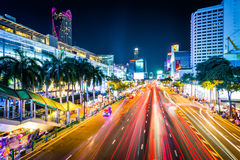 Long exposure of traffic and modern buildings on Ratchadamri Roa. D at night, at Siam, in Bangkok, Thailand Stock Photography