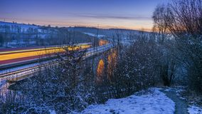 Long exposure of train on viaduct royalty free stock photography