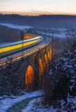 Long exposure of train on viaduct royalty free stock images