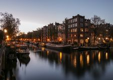 After sunset glow and canal reflections in Amsterdam stock photos