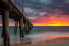 A long exposure of a vibrant sunset at the Port Noarlunga Jetty South Australia on 15th April 2019. Long exposure of a vibrant sunset at the Port Noarlunga Jetty stock images