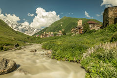 Long exposure view of village Usghuli with old stone towers under the highest georgian mountain Shkhara with glacier in Svaneti Stock Photography