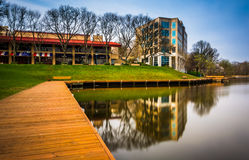 Long exposure of a walkway and buildings along the shore of Lake royalty free stock photo