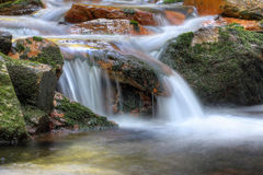 Long exposure of the water flowing over boulders Royalty Free Stock Image
