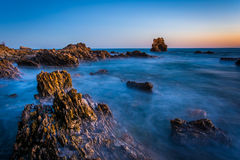 Long exposure of water and rocks at twilight stock photography