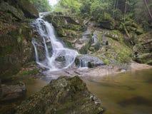 Long exposure waterfall Poledni vodopad  in Jizerske hory Jizera. Mountain, forest on Cerny potok black creek in czech republic, green mossed stones and ferns Royalty Free Stock Photo