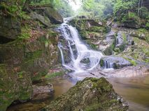 Long exposure waterfall Poledni vodopad  in Jizerske hory mounta. In forest on Cerny potok black creek in czech republic, green mossed stones and ferns Royalty Free Stock Photography