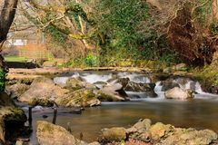 Waterfall on the river Sid in Sidmouth. Long exposure of a waterfall on the river  in mouth in Dorset Stock Image