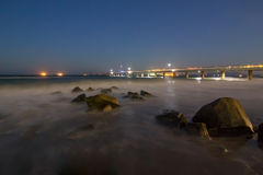 Long exposure waterscape. At twilight and old bridge royalty free stock photo