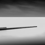Long exposure wavecutter. Black and white minimalistic seascape / daytime long exposure / black sea, odessa, ukraine Royalty Free Stock Photo