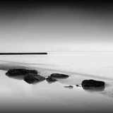 Long exposure wavecutter. Black and white minimalistic seascape / daytime long exposure / black sea, odessa, ukraine Stock Photos