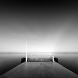 Long exposure wavecutter. Black and white minimalistic seascape / daytime long exposure / black sea, odessa, ukraine Royalty Free Stock Photos