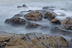 Long Exposure Waves and Rocks Stock Images