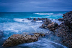 Long exposure of waves and rocks in the Pacific Ocean   Stock Image