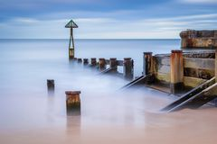 Long Exposure of Waymarker at Seaton Sluice harbour entrance. Seaton Sluice is a village on the Northumberland coast, with a natural harbour formed by the Seaton Stock Photo