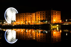 Long Exposure of Wheel of Liverpool. A long exposure shot of wheel of Liverpool and Albert Dock in Liverpool, England Stock Images