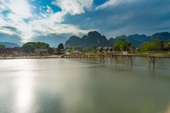 Long exposure Wood bridge on naw song river in Vang vieng, Laos. Long exposure Wood bridge on naw song river in Vang vieng, Laos Royalty Free Stock Images