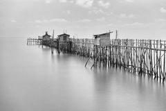 Long exposure of wooden fishing huts in black and white Royalty Free Stock Photography