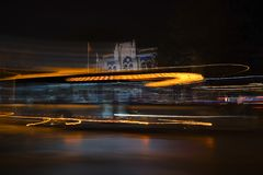 Long exposured light trails of bus stock photography