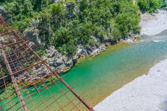 Long extreme suspension iron bridge across the river Moraca. Stock Photo