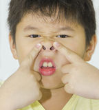 Long face. A boy pulling a long face royalty free stock photography
