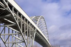 The long famous arched Fremont bridge across the Willamette Rive. Long famous biggest in America arched openwork two level transportation Fremont bridge across Royalty Free Stock Photos