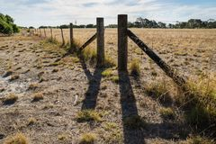 Long fence at a farmland in the Grampians, Victoria, Australia royalty free stock image