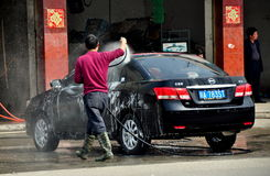 Long Feng, China: Man Washing Car Stock Images