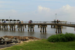 Long fishing pier with families enjoying the day,Jekyll Island,2015 Royalty Free Stock Photo