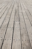 Long flat timbers of a new deck on a working dock on the New Eng Stock Photo