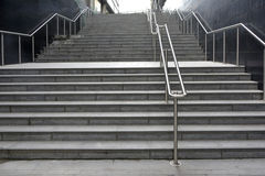 Long flight of steps. Long wide flight of outdoor steps with stainless steel handrails Stock Image