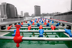 Long football table. A photo of a long football table with red and blue colors taken in outdoor Royalty Free Stock Photography