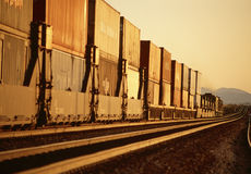 Long Freight Train with containers. Long Freight Train with container traveling thru California desert Stock Images